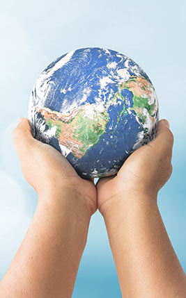 Pair of hands holding the Earth.